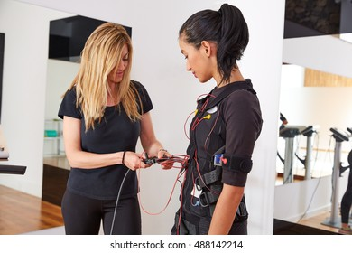 EMS electro stimulation coach suit helping women