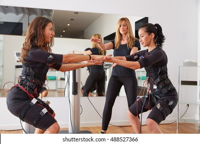 EMS electro stimulation women exercises with trainer coach