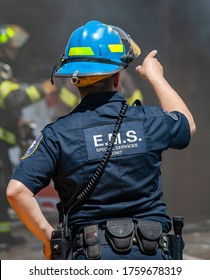 An EMT from an Emergency Services Unit at the scene of a commercial building fire