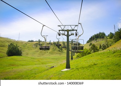 Emtpy chairlift in ski resort. Shot in summer with green grass and no snow