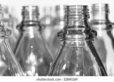 Emtpy transparent glass bottles isolated on white background.