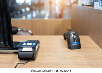Emty cashier desk counter POS terminal with barcode scanner, receipt printer, wallet and credit card reader equipment. Payment trade through mobile and wireless NFC technology. Workplace and career.