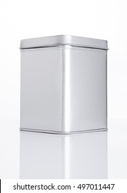Emty tea steel container jar on white background with reflection