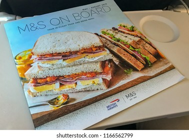 EN ROUTE PRAGUE TO LONDON HEATHROW - AUGUST 2018: Cover of an in-flight menu with British Airways logo and logo of Marks & Spencer, which provides the food for purchase by passengers.