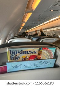"""EN ROUTE PRAGUE TO LONDON HEATHROW - AUGUST 2018: British Airways in-flight magazine and """"M&S On Board"""" menu for food provided by Marks & Spencer."""