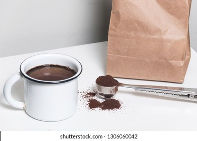 Enamel cup of coffee,coffee  in a sack and spoon