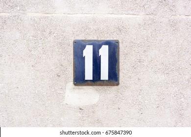 enameled house number eleven (11).