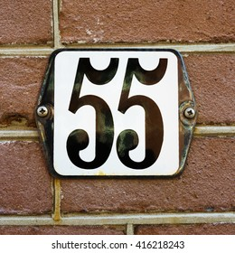 Enameled house number fifty five.