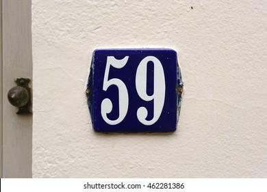 enameled house number fifty nine.