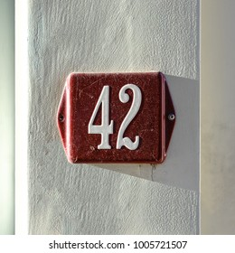 Enameled house number forty two (42)