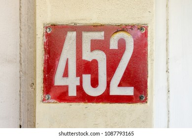 Enameled house number four hundred and fifty two (452)