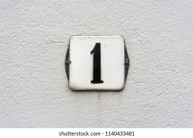 Enameled house number one (1)