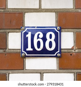 enameled house number one hundred and sixty eight