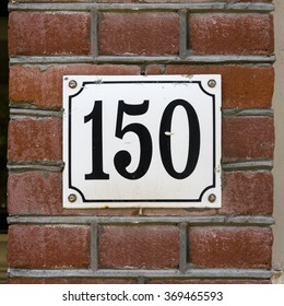 Enameled house number one hundred and fifty.