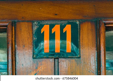 enameled house number one hundred and eleven (111)