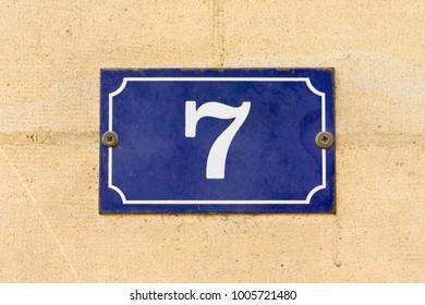 Enameled house number seven (7)