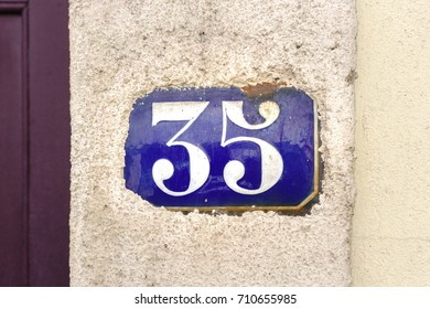 enameled house number thirty five (35)