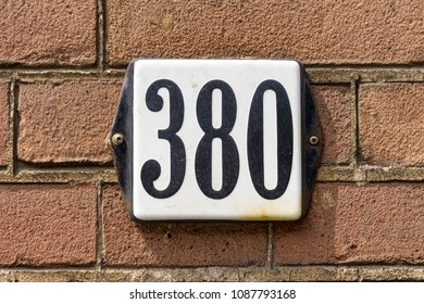Enameled house number three hundred and eighty (380)