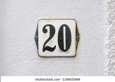 Enameled house number twenty (20)
