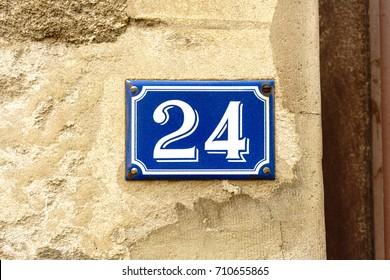 Enameled house number twenty four (24)