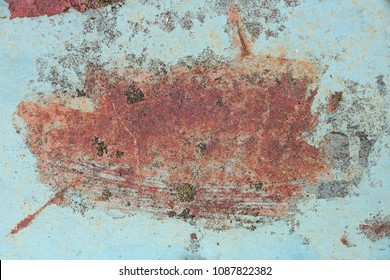 Enamelled blue surface of the hood of the old car cracked and rusted. Outdoor sunny day background