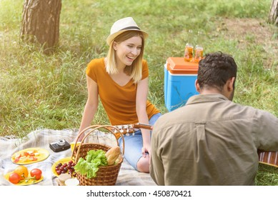 Enamored guy and girl resting in forest
