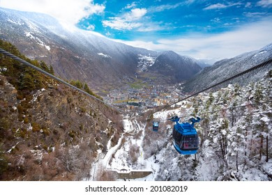 Encamp town in Andorra and cable car for lifting skiers and snowboarders to the top of the mountain