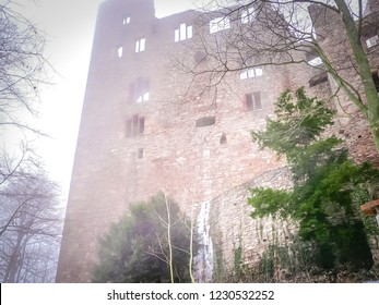 Enchanted Baden-baden ruins of the Middle Ages old castle Altes Schloss Hohenbaden in the fog with snow between trees in the Black Forest of the Baden-Wurttemberg region in the southwest of Germany
