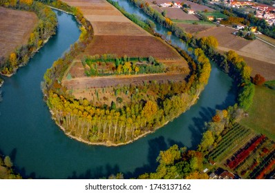 enchanting autumnal aerial view of a bend in the Brenta river near the village of Piazzola sul Brenta. Province of Padua, Veneto, Italy, Europe.