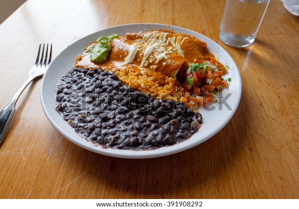 Enchiladas plate with rice and beans at a Mexican Restaurant for lunch.