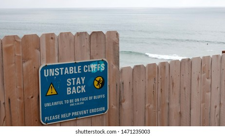 Encinitas, CA / USA - August 3, 2019: A sign warns of unstable cliffs at Grandview Beach, site of a deadly bluff collapse on August 2, 2019.