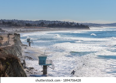 Encinitas, California USA - January 14th 2021 : Surfer getting ready to paddle out at San Elijo State Beach