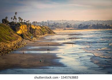 Encinitas, California / USA - Oct 27th 2019: Looking south along the shore of San Elijo state beach in Encinitas, CA.