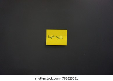 encouragement quote pink yellow color paper card notes by hand written cheering up words on dark wall decoration fight