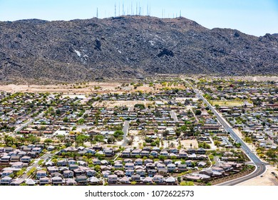 The encroachment of an expanding population meets the South Mountain Regional Park in the southwest desert as viewed from above