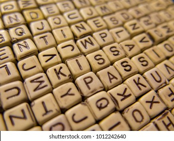 Encrypted words Kiss , the Passion of cubes with letters on the background of other letters