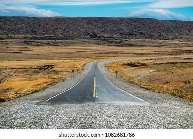 End of the asphalt road named Ruta 40 in Argentinian Patagonia. Asphalt road turns into gravel road on National road Ruta 40, Argentina.