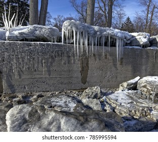"""End of December on Lake Erie, at Crystal Beach, Ontario. Significant waves, driven by high winds, have breached this breakwall repeatedly creating the start of """"Ice Sculpture Season""""."""