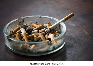 end fag , butt cigarette , ashtray grunge background