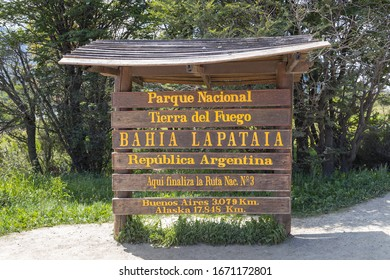 End of Pan-American highway - wooden road sign near End of the World, Lapataia bay in Tierra del Fuego national park, Ushuaia, Argentina
