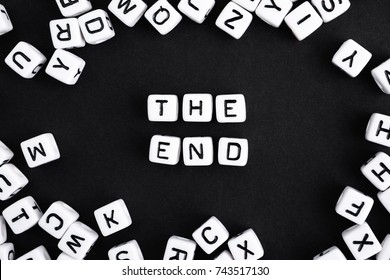 The end.  Playing words puzzle. Horizontal composition. A series of minimalism conceptual phrases and words.