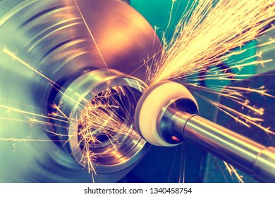 End processing of a metal surface with an abrasive stone on a circular grinding machine, sparks fly in different directions