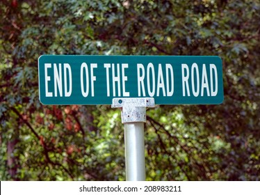 End of the Road Road humoristic and funny name of a direction corner street sign on directional traffic pole