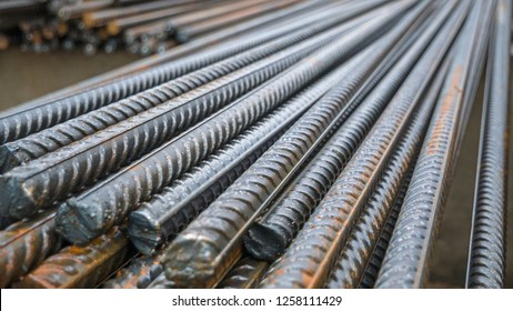 End of rustic of steel bar at the construction site. Rustic Metal Armature Rod. Building Construction Background