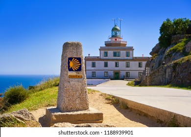 End of Saint James Way sign and lighthouse of Finisterre in Galicia Spain photomount