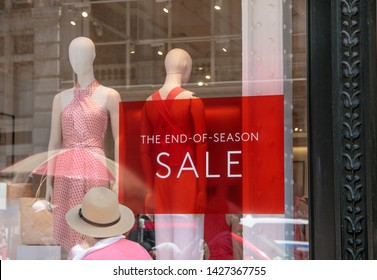 The end of season sale sign at a clothing store.