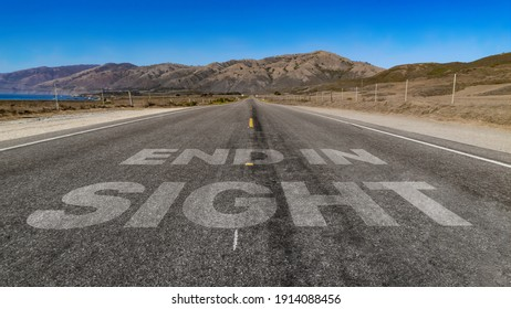 End in Sight written on highway road to the mountain