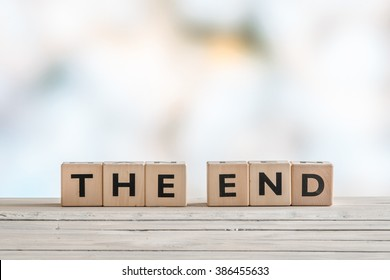 The end sign with wooden blocks on a table