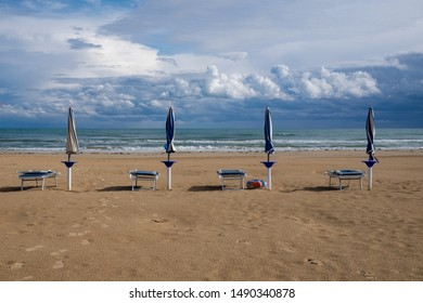 End of summer: beach umbrellas and storm coming up.