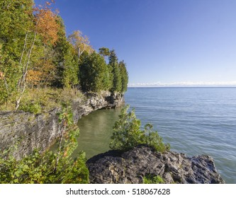 At the end of Whitefish Dunes State Park and adjacent to Cave Point County Park in Door County, Wisconsin, the bluff rises above Lake Michigan in autumn.